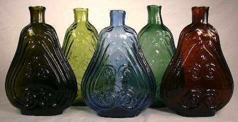 """""""Scroll"""" shaped figured flasks from the 1850s; click to enlarge."""